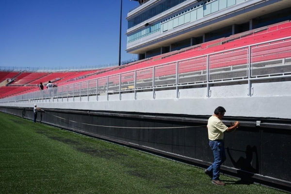 Gilbert Phelps of J.A. Tiberti measures the side of Sam Boyd Stadium on Thursday. Two rows of seats were removed -- reducing capacity by 860 seats -- in order to widen the playing surface to bette ...