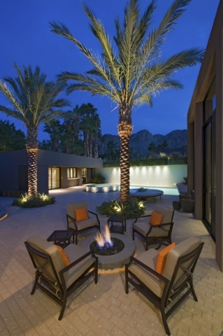 Today's fire pit is usually built of natural stone or trendy concrete, and designed to form an attractive part of the outdoor hardscape. THINKSTOCK