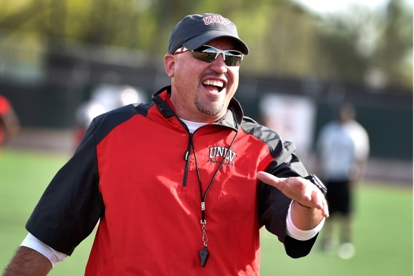UNLV football head coach Tony Sanchez smiles at visitors during the first day of spring practice at Rebel Park at UNLV on Monday, March 16, 2015, in Las Vegas. Sanchez is making his college debut  ...