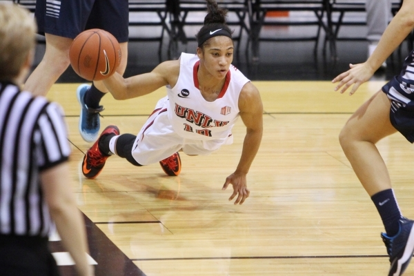 UNLV guard Nikki Wheatley gets off a pass before hitting the floor against Utah State during the first half of their Mountain West Conference game Wednesday, Feb. 25, 2015 at Cox Pavilion. (Sam Mo ...