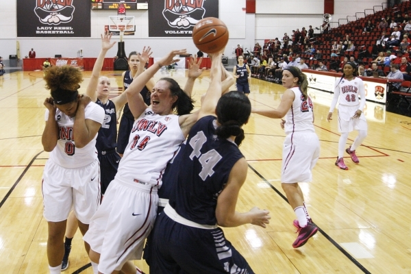 Utah State forward Franny Vaaulu grabs a rebound away from UNLV center Aley Rhode during the first half of their Mountain West Conference game Wednesday, Feb. 25, 2015 at Cox Pavilion. (Sam Morris ...