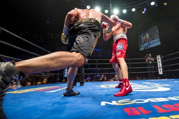 Beibut Shumenov, left, of Kazakhstan lunges at B.J. Flores during their Premier Boxing Champions interim cruiserweight title fight in the Pearl Theatre at The Palms on on Saturday. Shumenov (16-2, ...