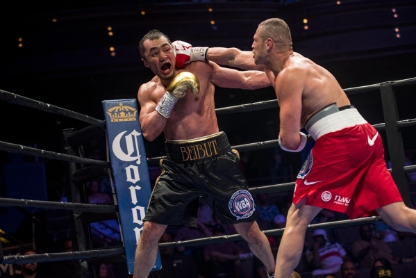 B.J. Flores, right, lands a punch to the head of Beibut Shumenov of Kazakhstan during their Premier Boxing Champions interim cruiserweight title fight in the Pearl Theatre at The Palms on on Satur ...