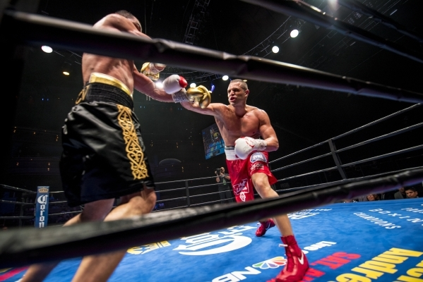 Beibut Shumenov, left, of Kazakhstan and B.J. Flores exchange punches during their Premier Boxing Champions interim cruiserweight title fight in the Pearl Theatre at The Palms on on Saturday. Shum ...