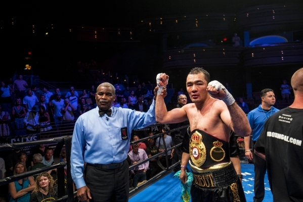 Beibut Shumenov celebrates after defeating B.J. Flores in their Premier Boxing Champions interim cruiserweight title fight in the Pearl Theatre at The Palms on on Saturday. Shumenov (16-2, 10 knoc ...