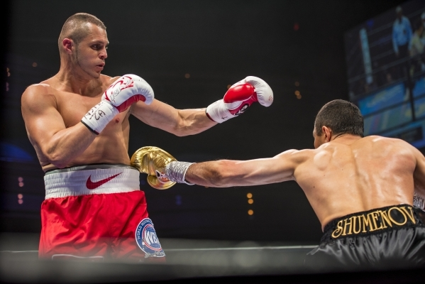 Beibut Shumenov, right, of Kazakhstan throws a jab at B.J. Flores during their Premier Boxing Champions interim cruiserweight title fight in the Pearl Theatre at The Palms on on Saturday. Shumenov ...