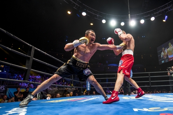 Beibut Shumenov, left, of Kazakhstan lands a punch to the body of B.J. Flores during their Premier Boxing Champions interim cruiserweight title fight in the Pearl Theatre at The Palms on on Saturd ...