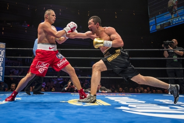 Beibut Shumenov, right, of Kazakhstan lands a punch to the body of B.J. Flores during their Premier Boxing Champions interim cruiserweight title fight in the Pearl Theatre at The Palms on on Satur ...