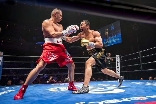 Beibut Shumenov, right, of Kazakhstan throws a punch at B.J. Flores during their Premier Boxing Champions interim cruiserweight title fight in the Pearl Theatre at The Palms on on Saturday. Shumen ...