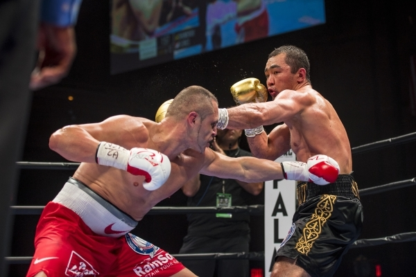 Beibut Shumenov, right, of Kazakhstan and B.J. Flores exchange punches during their Premier Boxing Champions interim cruiserweight title fight in the Pearl Theatre at The Palms on on Saturday. Shu ...