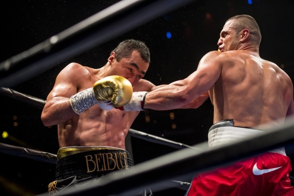 Beibut Shumenov, left, of Kazakhstan exchanges punches with B.J. Flores during their Premier Boxing Champions interim cruiserweight title fight in the Pearl Theatre at The Palms on on Saturday. Sh ...
