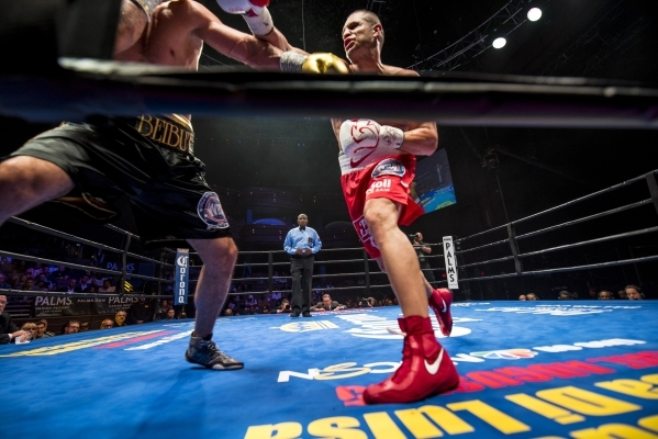 B.J. Flores, right, throws a punch at Beibut Shumenov of Kazakhstan during their Premier Boxing Champions interim cruiserweight title fight in the Pearl Theatre at The Palms on on Saturday. Shumen ...