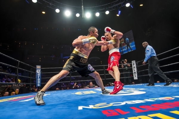 Beibut Shumenov, left, of Kazakhstan throws a jab  at B.J. Flores during their Premier Boxing Champions interim cruiserweight title fight in the Pearl Theatre at The Palms on on Saturday. Shumenov ...
