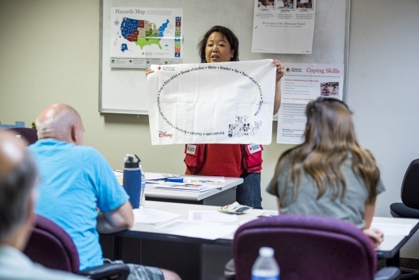 Lynn Rivera, a preparedness and response specialist, holds a pillow case Saturday as she instructs a Red Cross training class on the Pillowcase Project.  (Joshua Dahl/Las Vegas Review-Journal)