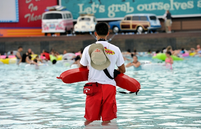 A lifeguard keeps his eyes on swimmers in the wave pool during the opening day of Cowabunga Bay in Henderson on Friday, July 4, 2014. (David Becker/Las Vegas Review-Journal)