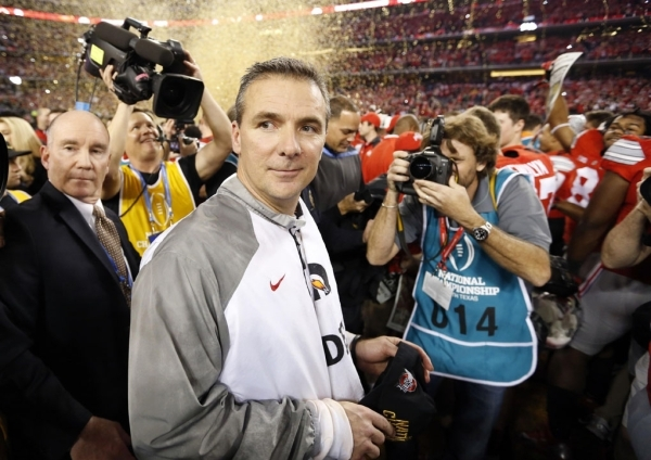 Ohio State Buckeyes coach Urban Meyer, shown after beating Oregon to capture the inaugural College Football Playoff National Championship in Arlington, Texas, on Jan. 12, may move senior Braxton M ...