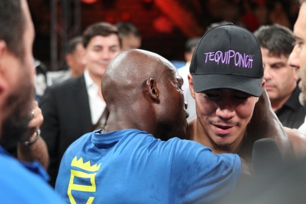 Timothy Bradley Jr., left, and Jessie Vargas speak at the end of their WBO welterweight title match at the StubHub Center in Carson, Calif., on June 27. Bradley won by unanimous decision when the  ...