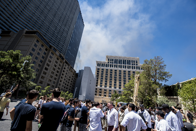 Guest and employees are evacuated due to a fire at the pool of The Cosmopolitan hotel-casino on the strip in Las Vegas on Saturday, July 25, 2015. (Joshua Dahl/Las Vegas Review-Journal)