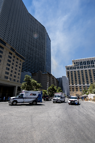Ambulances respond to a fire at the pool of The Cosmopolitan hotel-casino on the strip in Las Vegas on Saturday, July 25, 2015. (Joshua Dahl/Las Vegas Review-Journal)