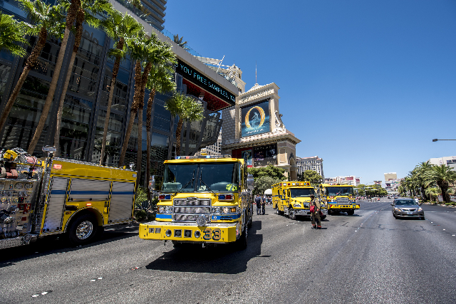 Clark County and Las Vegas fire units park on Las Vegas Blvd as they respond to a fire at the pool of The Cosmopolitan hotel-casino on the strip in Las Vegas on Saturday, July 25, 2015. (Joshua Da ...