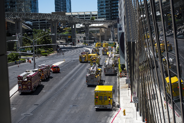 Clark County and Las Vegas fire units park on Harmon Avenue as they respond to a fire at the pool of The Cosmopolitan hotel-casino on the strip in Las Vegas on Saturday, July 25, 2015. (Joshua Dah ...