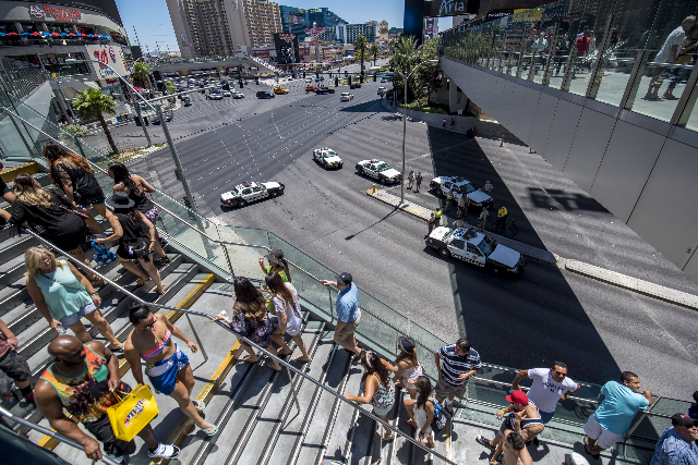 Las Vegas Metro Police block off the intersection of Las Vegas Blvd and Harmon Ave due to a fire at the pool of The Cosmopolitan hotel-casino on the strip in Las Vegas on Saturday, July 25, 2015.  ...