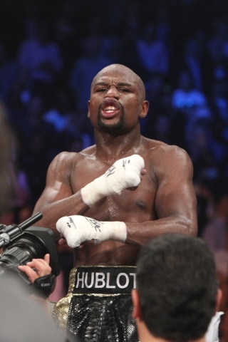 Floyd Mayweather Jr. celebrates after winning his welterweight title unification fight against Manny Pacquiao at the MGM Grand Garden on May 2. Mayweather is expected this week to name an opponent ...