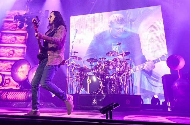 "Geddy Lee, left, and Neil Peart, on drums, of Rush perform at the MGM Grand Garden Arena as part of their ""R40 Live 40th Anniversary Tour"" in Las Vegas on Saturday, July 25, 2015. (Chase ..."