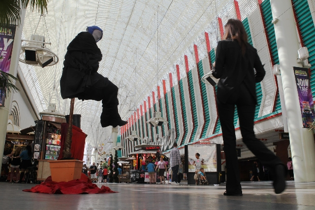 Ron Pickerel, otherwise known as Levitar, performs on Fremont Street on Tuesday, July 28 2015. The city hopes to erect performances zones for street performers in an attempt to clean up downtown.