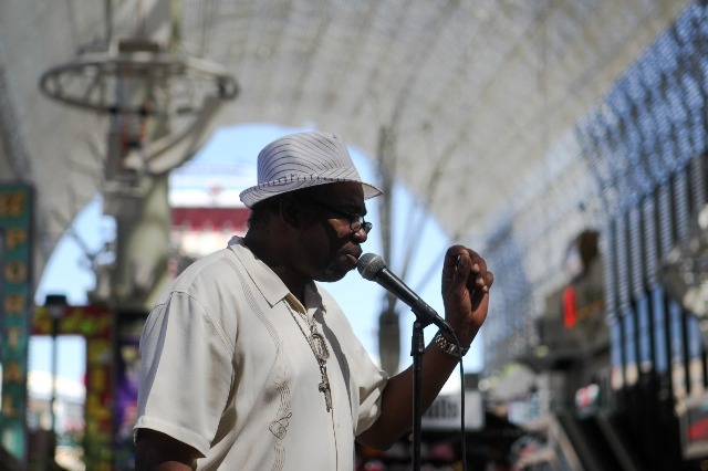 Frank Anderson, otherwise known as Big Frank, sings on Fremont Street on Tuesday, July 28 2015. The city hopes to erect performances zones for street performers in an attempt to clean up downtown.