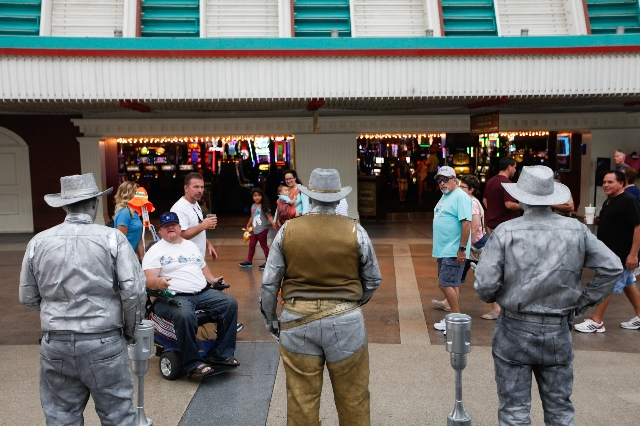 The Silver and Gold statues perform on Fremont Street on Wednesday, July 29 2015. The city hopes to set up zones for street performers on Fremont Street.