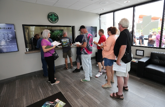 Customers fill prescriptions at Silver State Relief in Sparks on Friday morning, July 31, 2015. More than 50 people with state-authorized medical cards lined up for the opening of the first medica ...