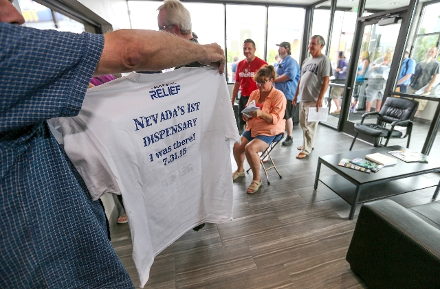 A customer who declined to give his name shows off a t-shirt he received after filling a prescription at Silver State Relief, in Sparks on Friday morning, July 31, 2015. More than 50 people with s ...