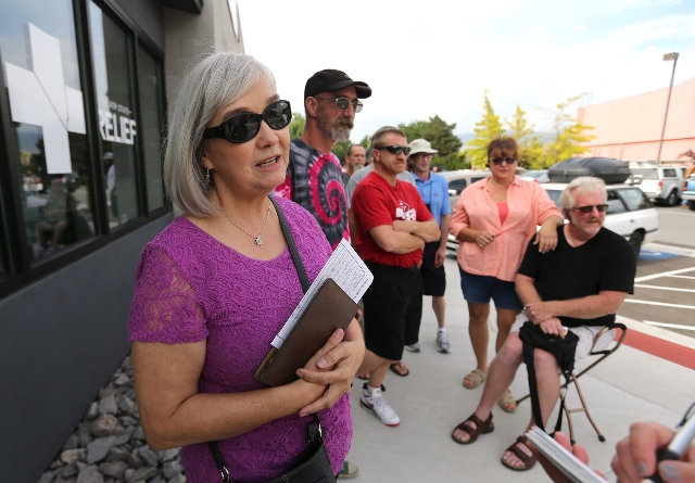 Linda Seibert waits in line outside Silver State Relief in Sparks on Friday, July 31, 2015. More than 50 people with state-authorized medical cards lined up for the opening of the first medical ma ...