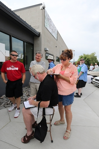 Jerry Young and Barbara Dunn fill out paperwork while waiting for the opening of Silver State Relief in Sparks on Friday, July 31, 2015. More than 50 people with state-authorized medical cards lin ...