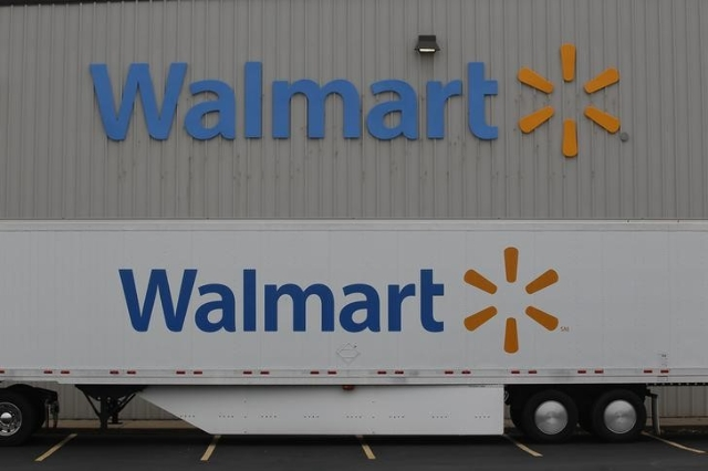 The Wal-Mart company logo is seen outside a Wal-Mart Stores Inc company distribution center in Bentonville, Arkansas June 6, 2013. (Rick Wilking/Reuters)