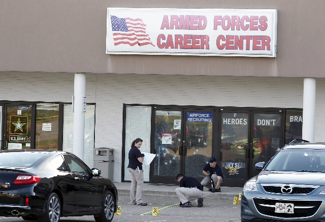 FBI agents work the scene at the Armed Forces Career Center in Chattanooga, Tennessee, July 16, 2015. (Tami Chappell/Reuters)