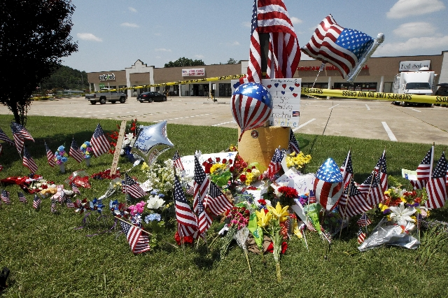 Items left at a memorial at the Armed Forces Career Center are seen in Chattanooga, Tennessee, July 17, 2015. Four U.S. Marines were killed on Thursday by a suspected gunman the FBI has confirmed  ...