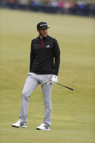 Jul 19, 2015; St. Andrews, Fife, SCT; Dustin Johnson looks disappointed after hitting his second shot on the 18th hole during the third round of the 144th Open Championship at St. Andrews - Old Co ...