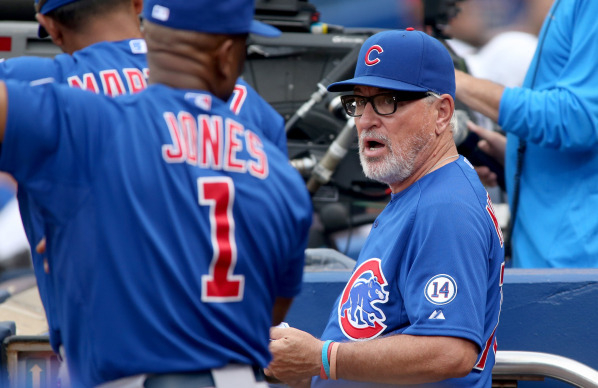 Chicago Cubs manager Joe Maddon, right, shown talking with third base coach Gary Jones during a game against the Atlanta Braves on July 19, has challenged umpiring calls 31 times this season. (Jas ...