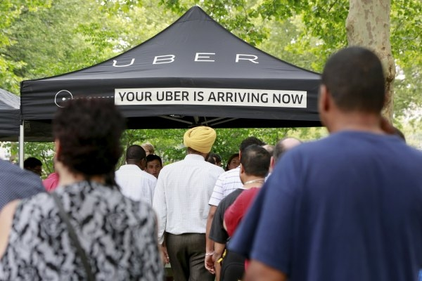 People wait Tuesday to register for the Uber citywide jobs tour in the Queens borough of New York. The jobs tour brings together Uber-driver partners and others who have the interest in joining th ...