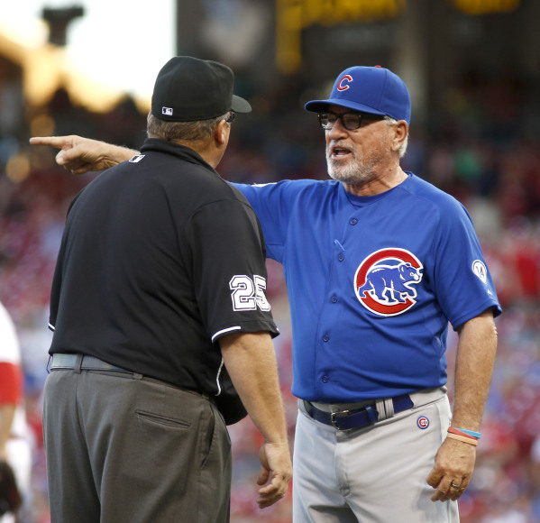 Chicago Cubs manager Joe Maddon tries to make his point to second base umpire Fieldin Culbreth in a game against the Cincinnati Reds on July 22. Maddon has used instant replay to challenge umpirin ...