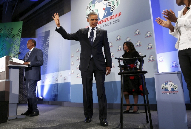 President Barack Obama, center, and Kenya's President Uhuru Kenyatta, left, arrive onstage to deliver remarks at the Global Entrepreneurship Summit at the United Nations compound in Nairobi  ...