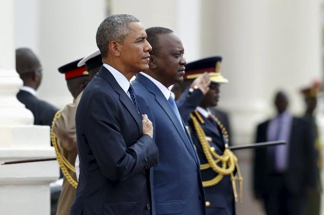 President Barack Obama, left, takes part in a reception ceremony next to Kenya's President Uhuru Kenyatta as he visits the State House in Kenya's capital Nairobi, July 25, 2015. (Thoma ...