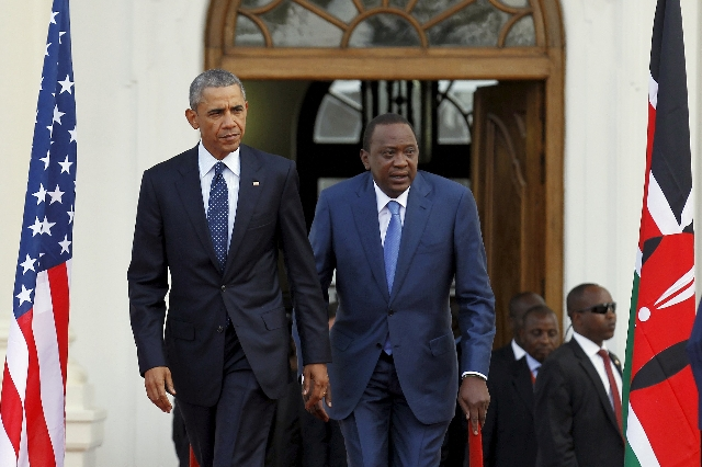 President Barack Obama, left, arrives with Kenya's President Uhuru Kenyatta for a joint news conference after their meeting at the State House in Nairobi July 25, 2015. (Thomas Mukoya/Reuters)