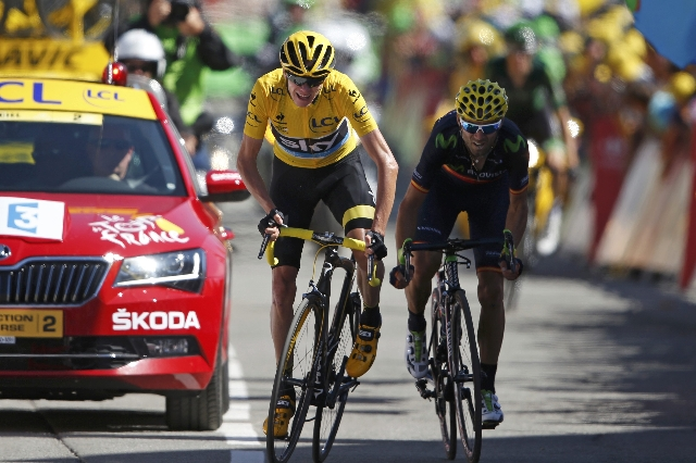 Team Sky riders Chris Froome of Britain (L), the race overall leader's yellow jersey, and Movistar rider Alejandro Valverde of Spain, sprint at the finish line of the 110.5-km (68.6 miles) 2 ...