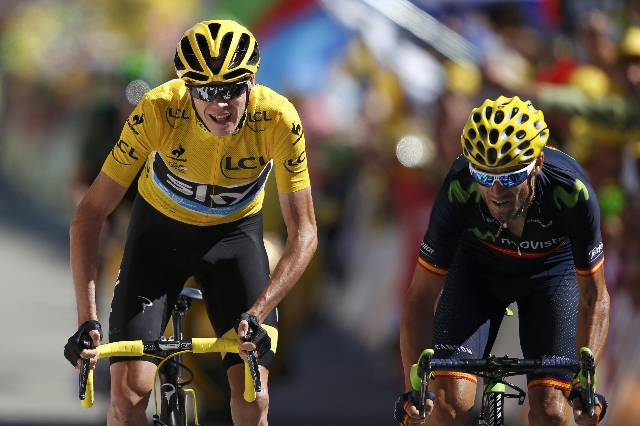 Team Sky rider Chris Froome of Britain, the race overall leader's yellow jersey, and Movistar rider Alejandro Valverde of Spain sprint at the finish line of the 110.5-km (68.6 miles) 20th st ...