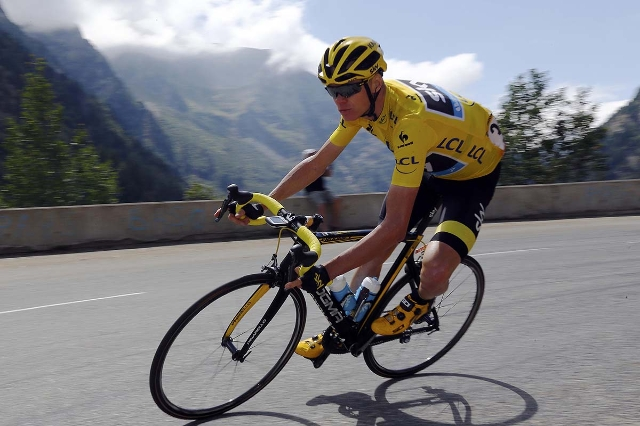 Team Sky rider Chris Froome of Britain wears the race leader's yellow jersey as he speeds downhill during the 110.5-km (68.6 miles) 20th stage of the 102nd Tour de France cycling race from M ...
