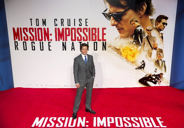 "U.S. actor Tom Cruise poses for photographers at a British screening of the film ""Mission Impossible: Rogue Nation"" in London, Britain July 25, 2015. (Neil Hall/Reuters)"