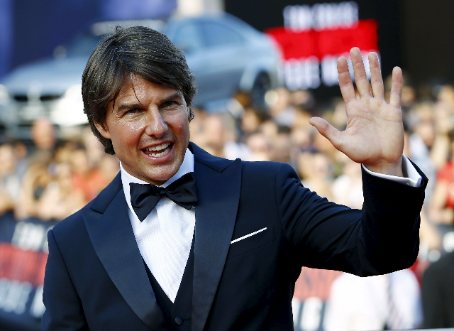 "Tom Cruise waves to fans upon his arrival for the world premiere of ""Mission Impossible - Rogue Nation"" in front of State Opera house in Vienna, Austria, July 23, 2015. (Leonhard Foeger/ ..."